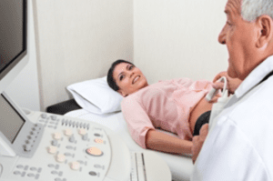 Pregnant woman with ultrasound
